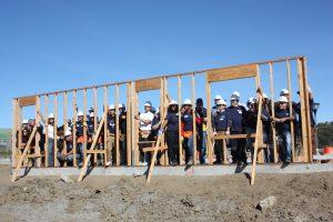 Volunteers building a wall
